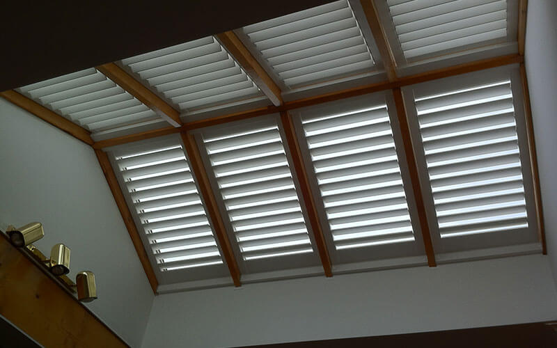 An an array of aluminium shutter blinds used as a skylight filter