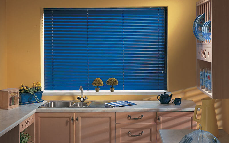 Blue aluminium blinds in a Canberra kitchen supplied by The Blind Shop