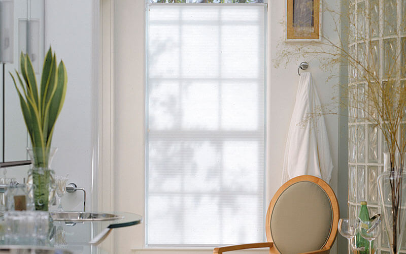 an image of honecomb blinds in a modern bathroom