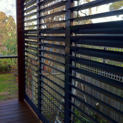 Outdoor aluminium shutter blinds in navy from The Blind Shop in Canberra