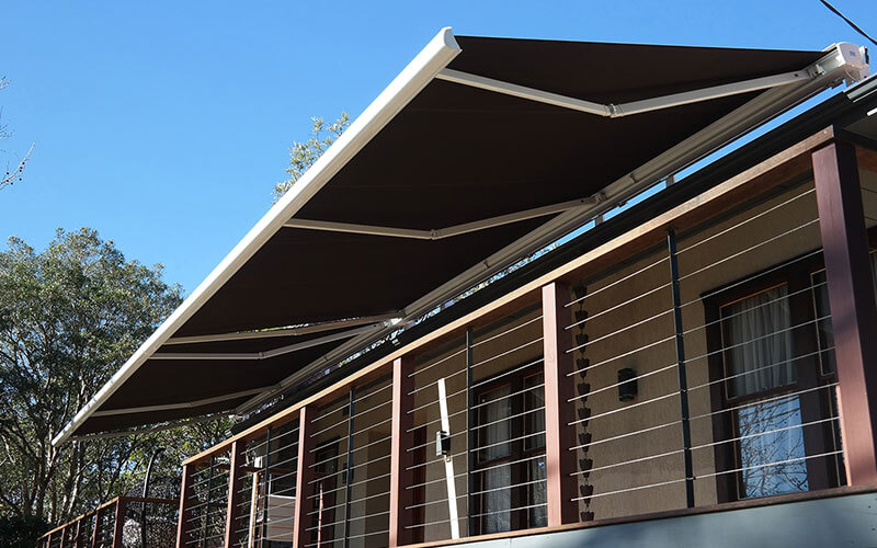 A canberra balcony with a retractable awning from the blind shop