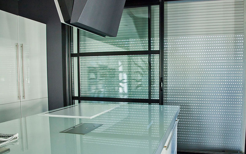 Roller shutter blinds in a modern Canberra Kitchen. The Blind Shop can install yours today!