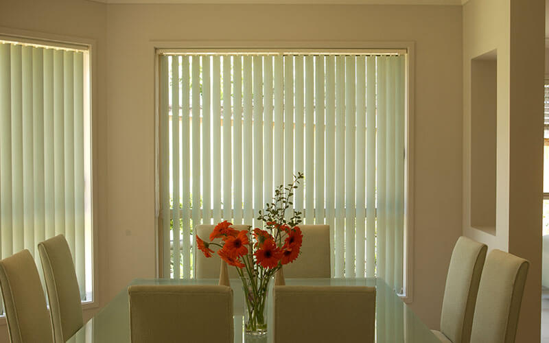 a canberra dining room with vertical blinds from The Blind Shop